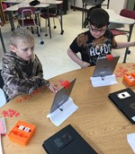 Students using the Osmo system.