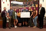 SSADD members and school administrators with a donation check