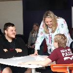 Seniors visit sixth graders