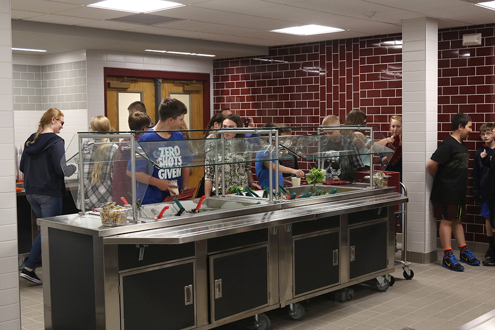 Students using salad bar in new kitchen/cafeteria at high school