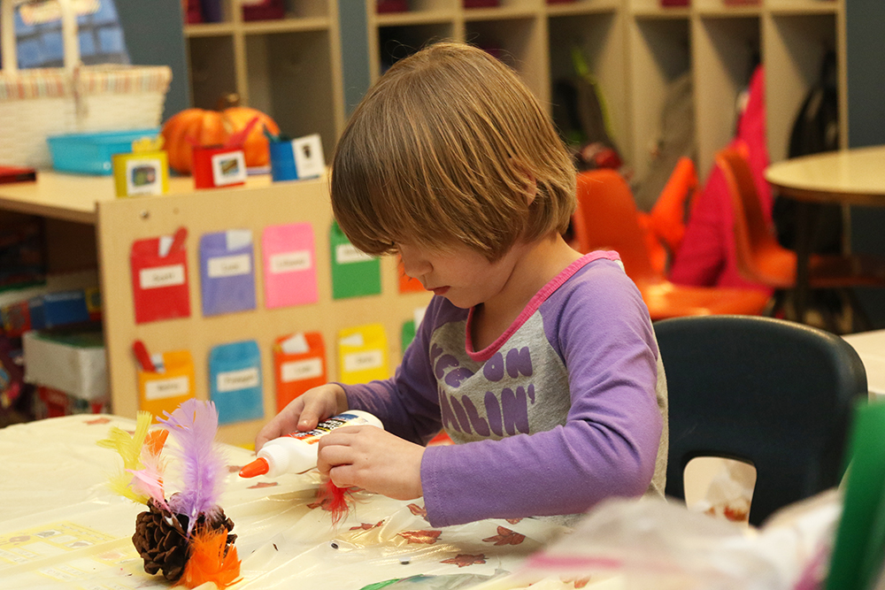 Kindergartners working on a Thanksgiving project