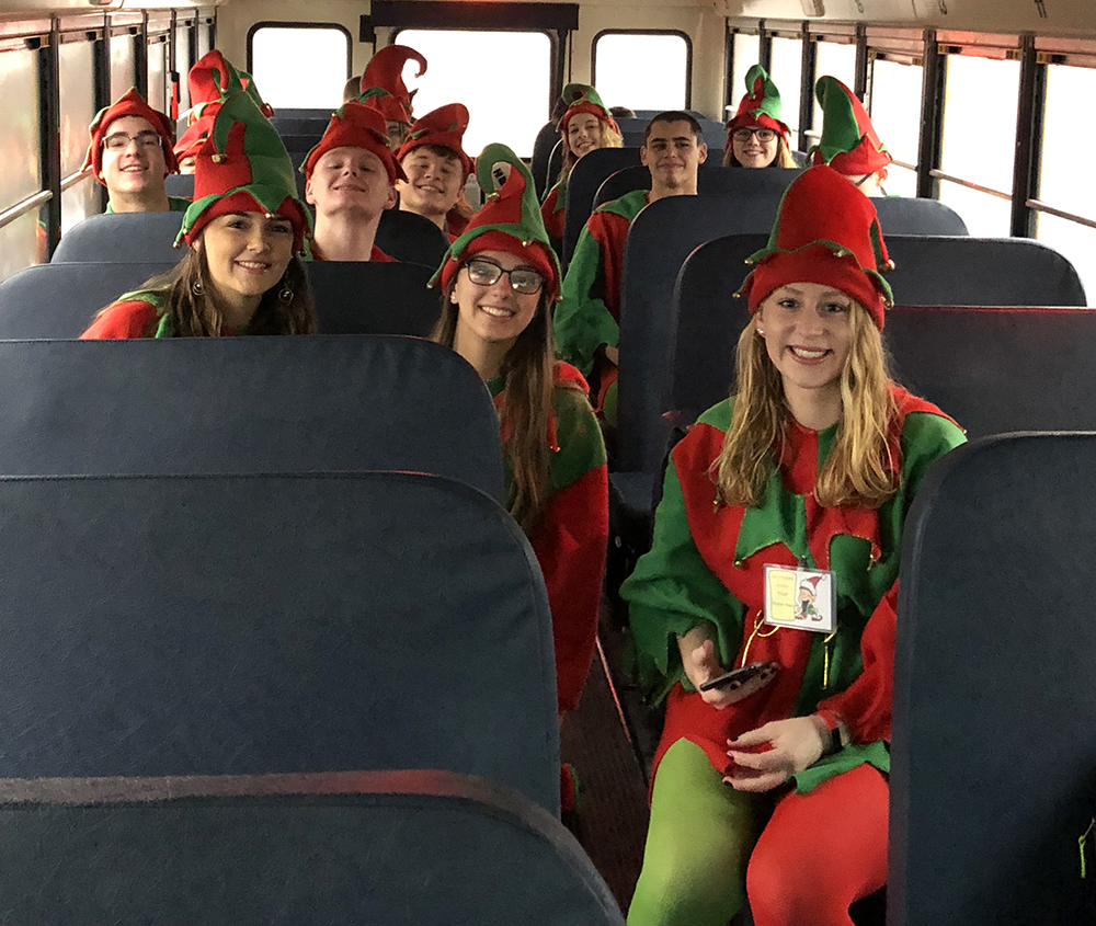 Sidney elves en route to the Discovery Center