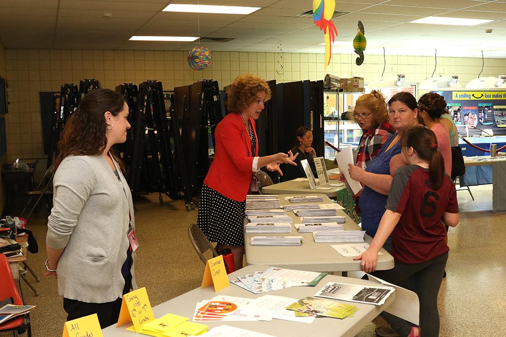 Staff members talking to community members