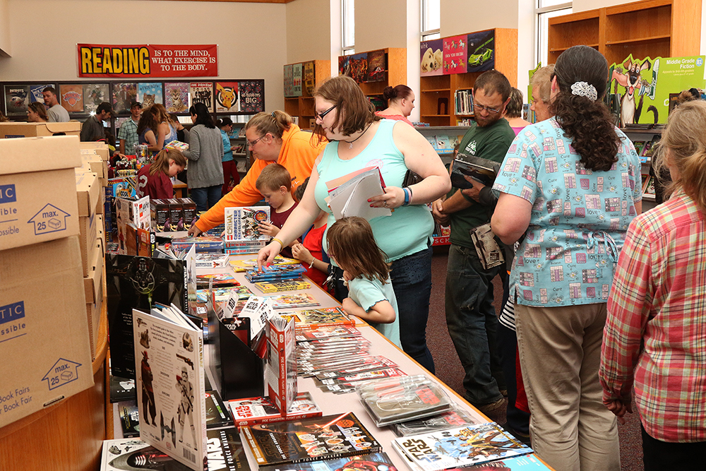 Children and adults at book fair