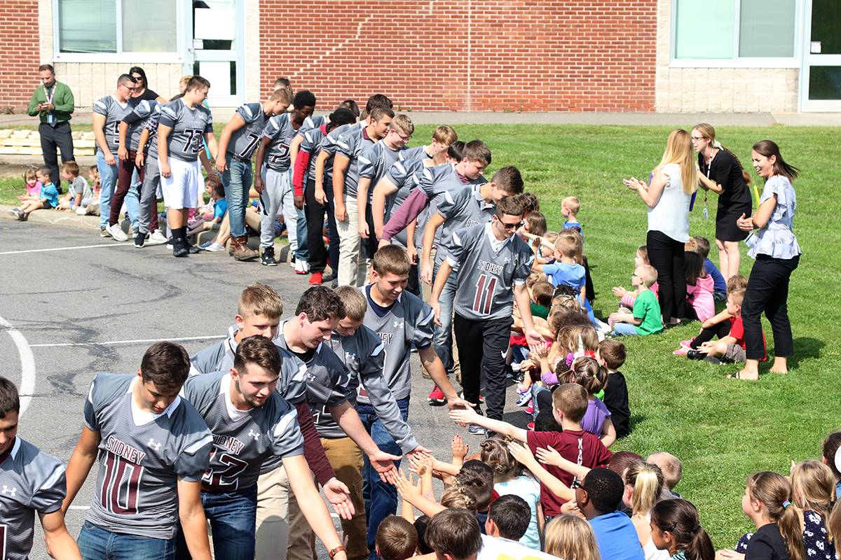 Circle of athletes during homecoming week