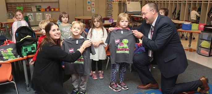 Kindergartners receiving Primary Academy shirts