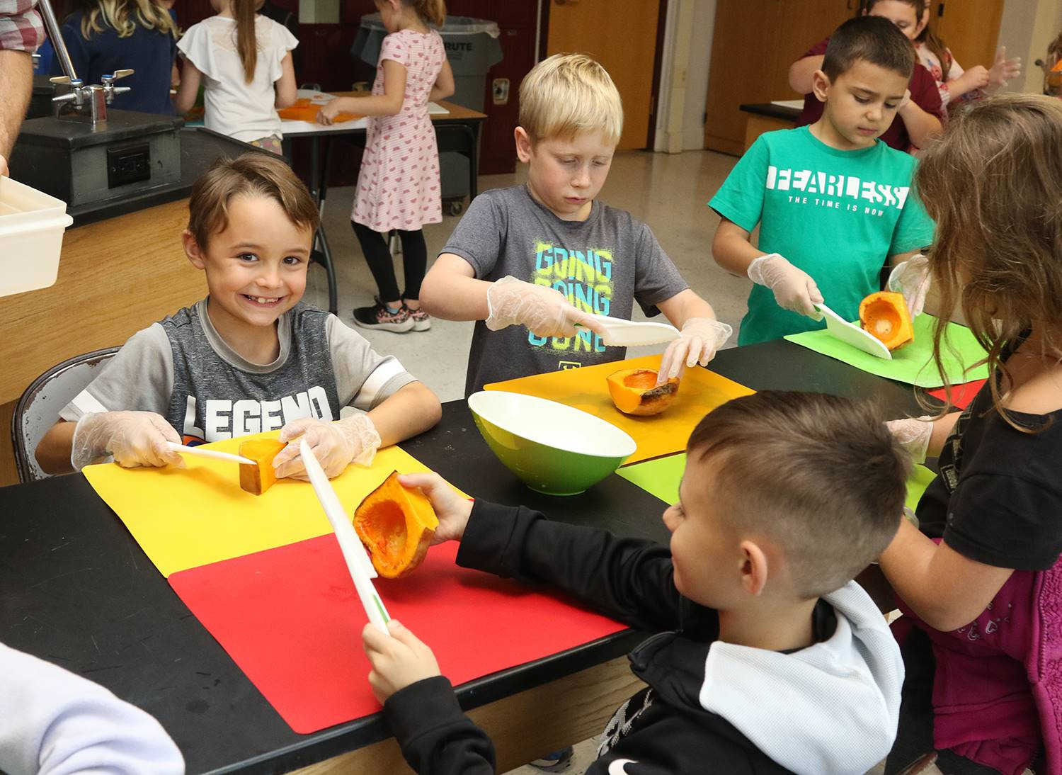 Elementary students working on squash soup