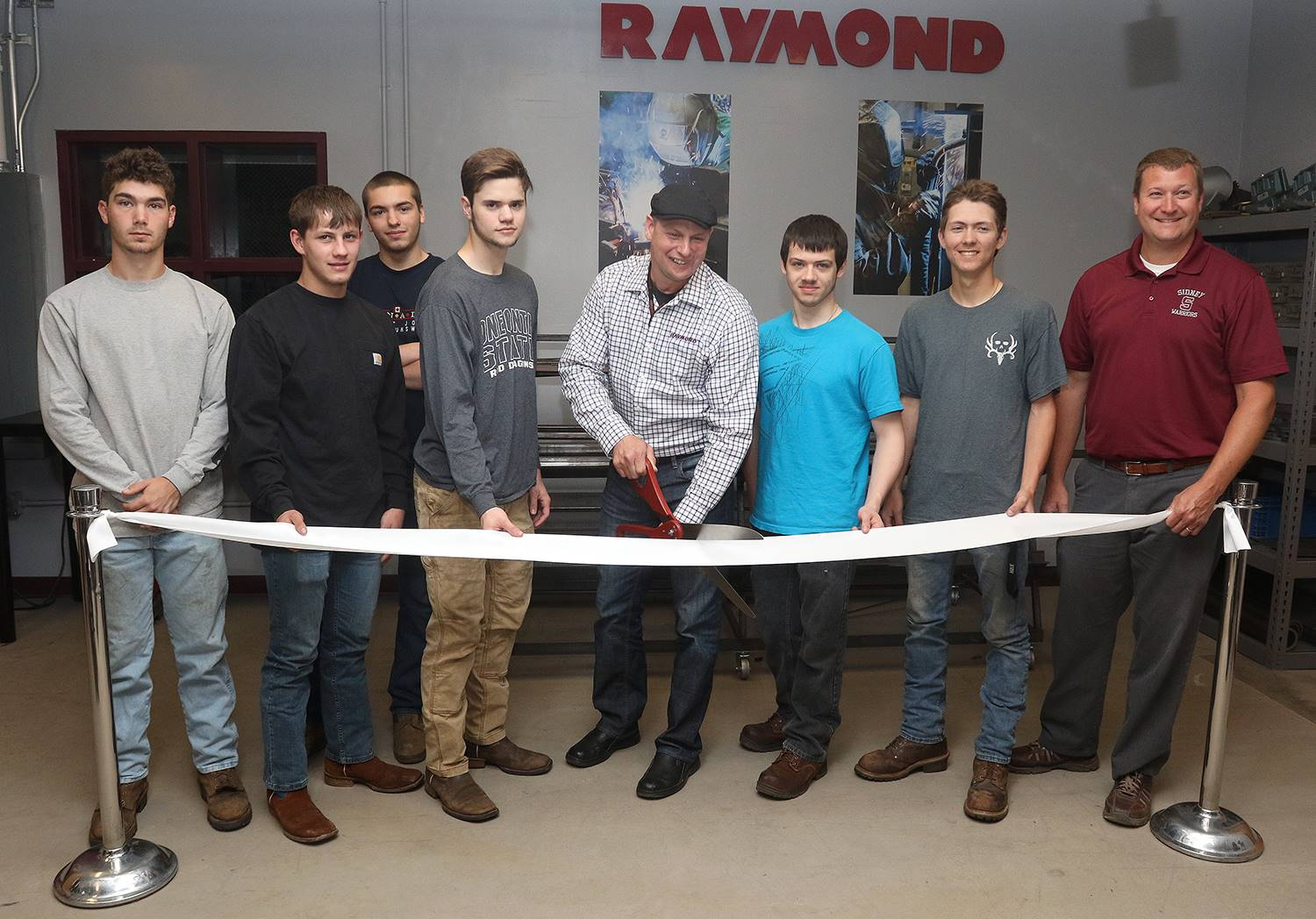 Ribbon cutting of new Raymond welding room at Sidney CSD.