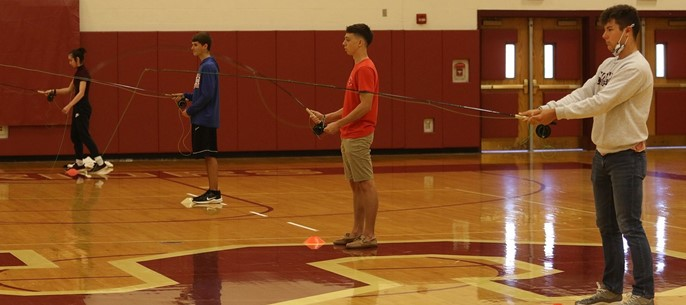 High school PE class learning fly fishing