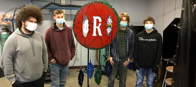 Sidney welding students with project